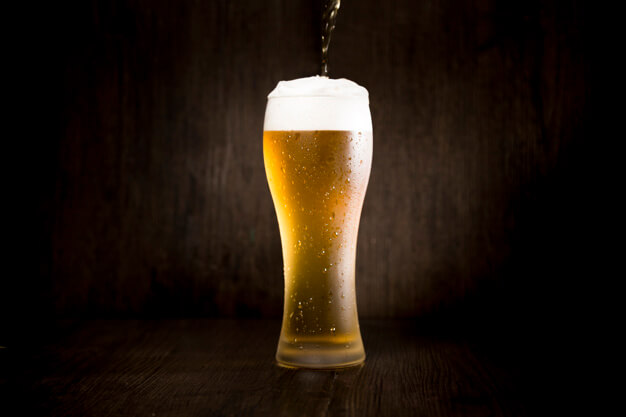 beer-glass-front-black-background_23-2148098815